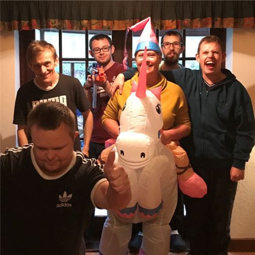Guys and a blow up unicorn